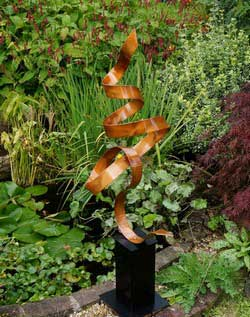 a copper coloured garden sculpture - main